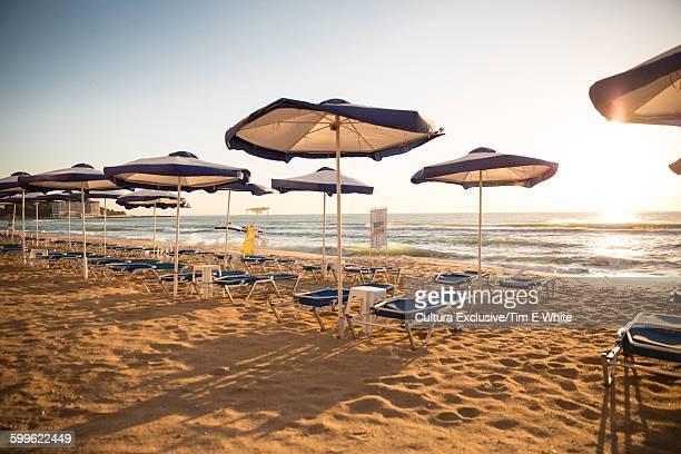 Sun umbrellas and empty sun loungers on beach, Varna, Bulgaria