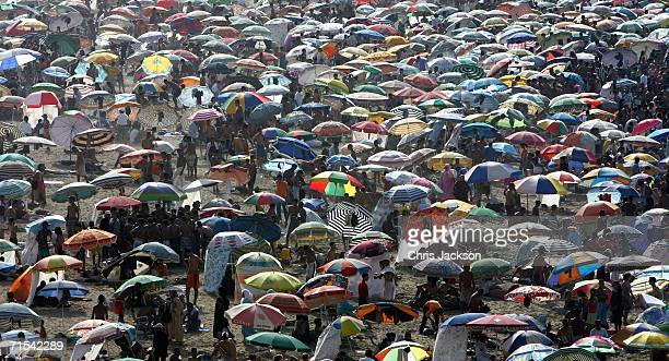 Sun umbrellas are seen as people spend the day swimming on the beach during Throne Day Celebrations on July 30 2006 in Rabat Morocco The celebrations...
