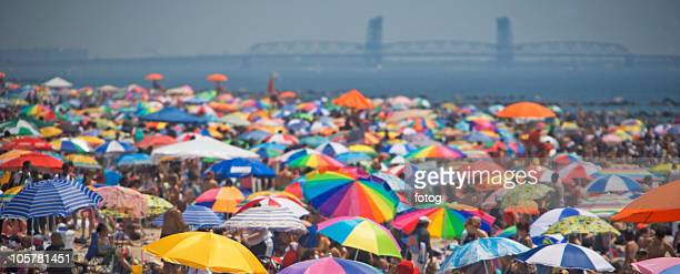 sun umbrellas at the beach - coney island stock pictures, royalty-free photos & images