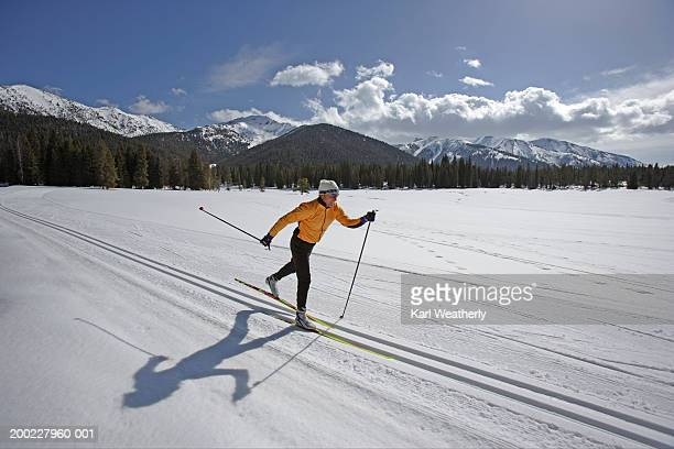 usa, sun valley, idaho, mature man cross-country skiing - sun valley idaho stock photos and pictures