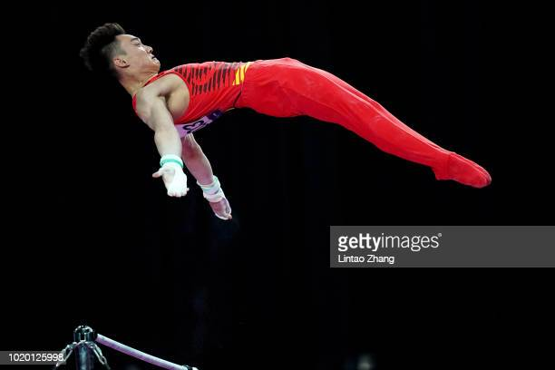 Sun Wei of China competes on the Parallel Bars in qualification one of the artistic gymnastics event on day two of the Asian Games on August 20, 2018...