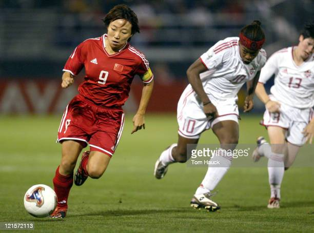 Sun Wen of China heads up field during game action at PGE Park in Portland Oregon October 2 2003 Canada defeated China 10 in The 2003 Women's World...