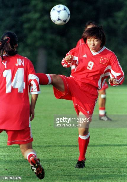 Sun Wen of China's Women's World Cup soccer team heads a ball during a team practice at Babson College 02 July 1999 in Wellesley Massachusetts The...