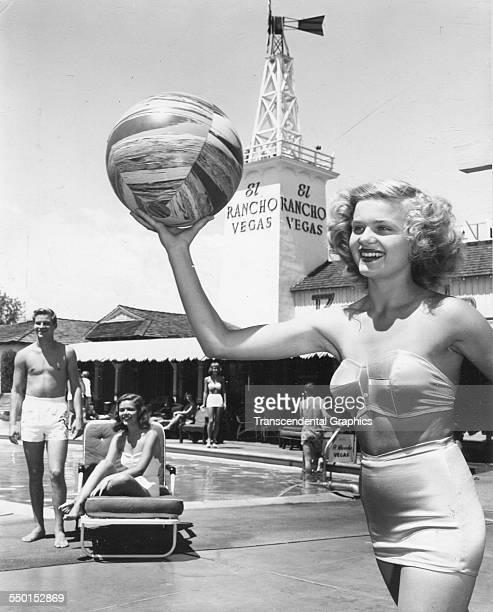 A sun worshiper plays by the swimming pool at El Rancho Vegas resort Las Vegas Nevada 1949