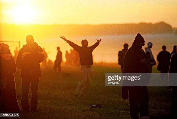 A sun worshipper having a moment Summer Solstice June UK 2005