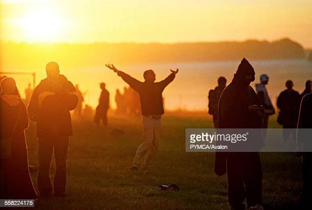 Sun worshipper having a moment, Summer Solstice, June UK 2005.