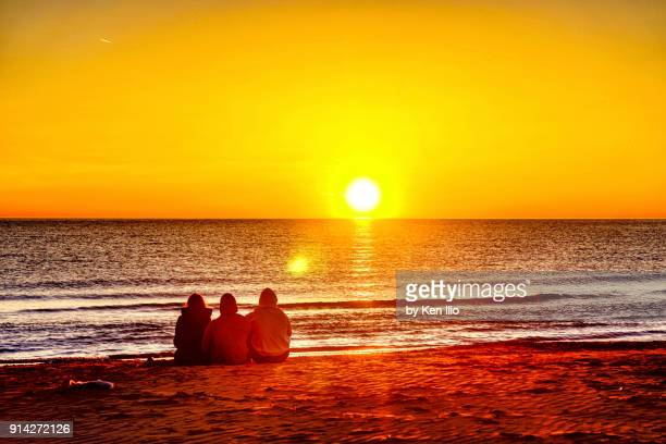 Sun worshippers watching the sunrise over Lake Michigan