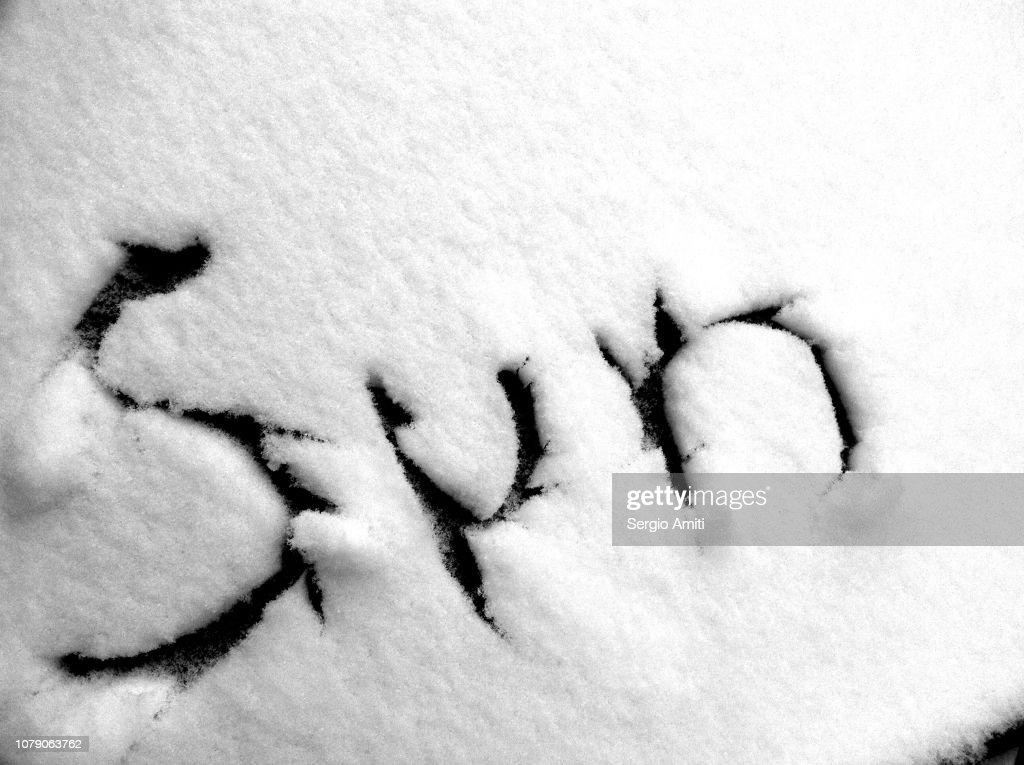 Sun written in snow : Stock Photo