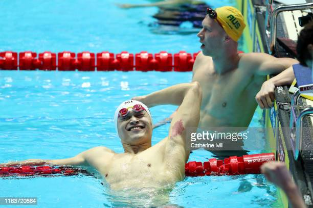 Sun Yang of China celebrates as Clyde Lewis of Australia looks on after the Men's 200m Freestyle Final on day three of the Gwangju 2019 FINA World...