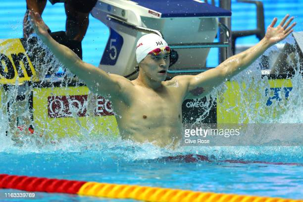 Sun Yang of China celebrates in the Men's 400m Freestyle Final on day one of the Gwangju 2019 FINA World Championships at Nambu International...