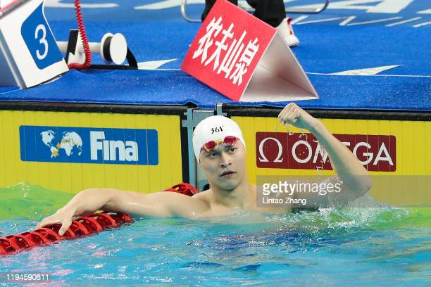 Sun Yang of China celebrates winning the gold medal after competing in the Men's 400m Freestyle Final during the day two of FINA Champions Swim...