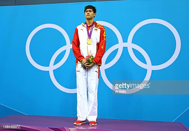Sun Yang of China celebrates with his gold medal durng the Medal ceremony for the Men's 400m Freestyle on Day One of the London 2012 Olympic Games at...