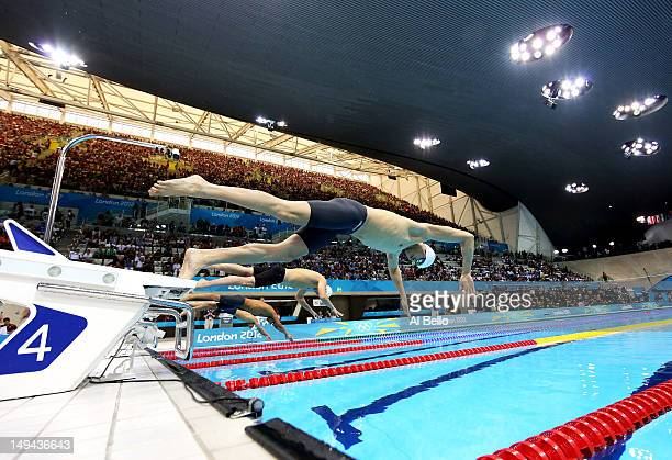 Sun Yang of China dives off of the starting block as he competes in heat four of the Men's 400m Freestyleon Day One of the London 2012 Olympic Games...