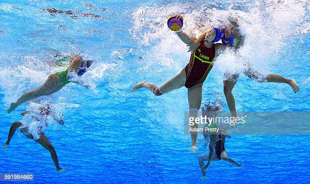 Sun Yating of China is challenged during the Women's Water Polo 7th 8th Classification match between Brazil and China on Day 14 of the Rio 2016...