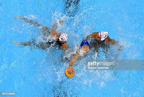Sun Yating of China is tackled by Clara Espar Llaquet and Laura Lopez Ventosa of Spain in the Women's Water Polo match between Spain and China at...