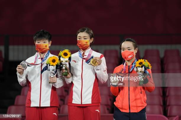 Sun Yingsha and Chen Meng of Team China, and Ito Mima of Team Japan pose for photographs during the medal ceremony of the Women's Singles table...