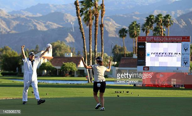 Sun Young Yoo of South Korea celebrates holing her winning putt with her caddie Adam Woodward during her playoff win against IKKim of South Korea...