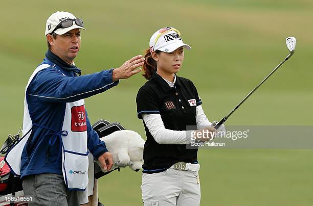 Sun Young Yoo of South Korea lines up a shot on the second hole with her caddie Adam Woodward during the second round of the CME Group Titleholders...