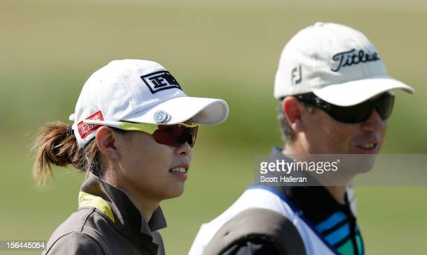 Sun Young Yoo of South Korea walks on the second hole with her caddie Adam Woodward during the first round of the CME Group Titleholders at the...