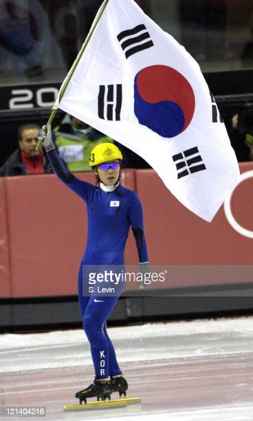Sun Yu Jin of Korea celebrates a gold medal during the Speed Skating Short Track Women's 1000 m race at the 2006 Olympic Games held at the Palavela...