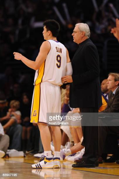 Sun Yue of the Los Angeles Lakers is directed during the game against the Milwaukee Bucks by Head Coach Phil Jackson at Staples Center on December 7...