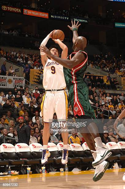 Sun Yue of the Los Angeles Lakers shoots against the Milwaukee Bucks at Staples Center on December 7 2008 in Los Angeles California Sun converted the...