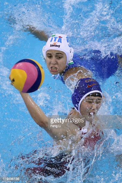 Sun Yujun of China shoots a goal in the Women's Water Polo first preliminary round match between China and Italy during Day Six of the 14th FINA...
