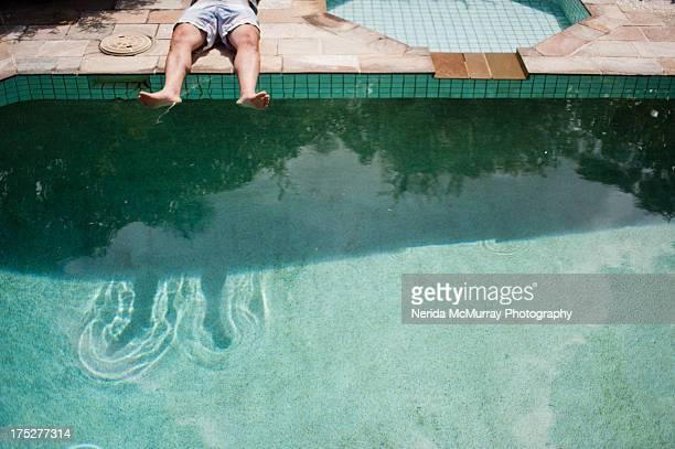 Sunbaking legs near pool
