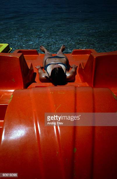 sunbath on the pedal bat - pedal boat stock pictures, royalty-free photos & images