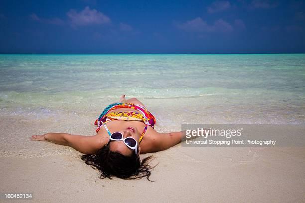 sunbather on maldives sandbar - male maldives stock pictures, royalty-free photos & images