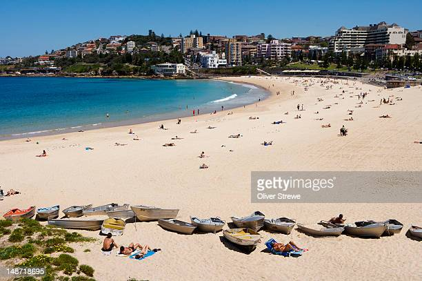 Sunbathers and boats on Coogee beach.