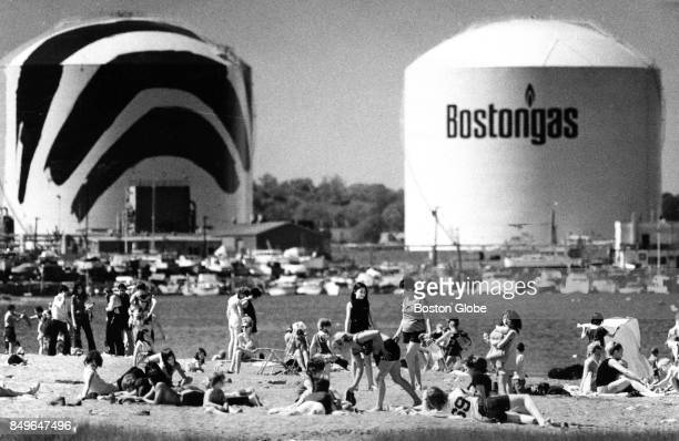 Sunbathers Are Pictured At Tenean Beach In The Dorchester Neighborhood Of Boston With A Pair
