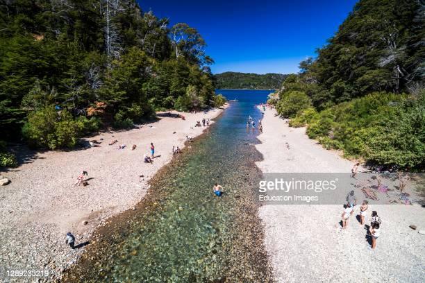 Sunbathers at Lago Perito Moreno Este, San Carlos de Bariloche, Rio Negro Province, Patagonia, Argentina, South America.