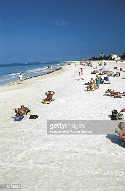 Sunbathers at Siesta Key Beach, Sarasota, Florida.