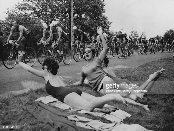 Sunbathers at the side of the road cheer the riders on the 6th stage of the Tour de France between Quimper and La BaulePornichet 27th June 1965