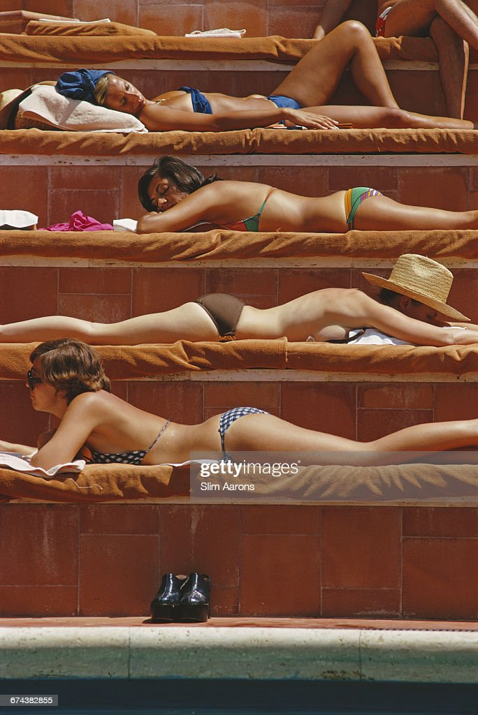 Sunbathers by a swimming pool in Capri, Italy, August 1974.