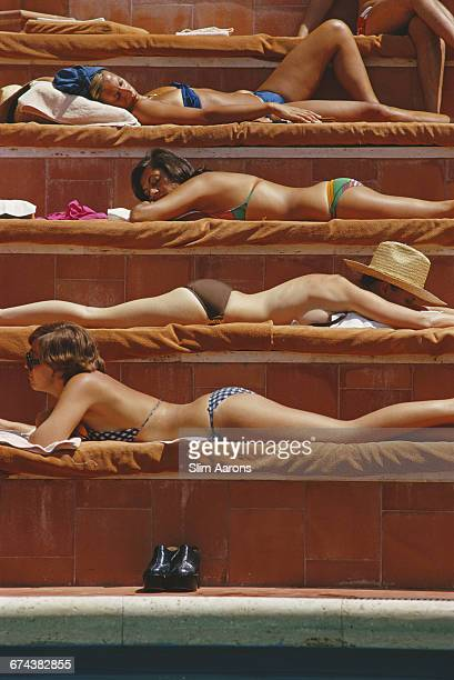 Sunbathers by a swimming pool in Capri Italy August 1974