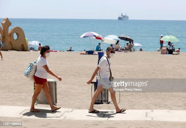 Sunbathers enjoy along the beach of La Malagueta on July 19 2020 in Malaga Andalucia Spain