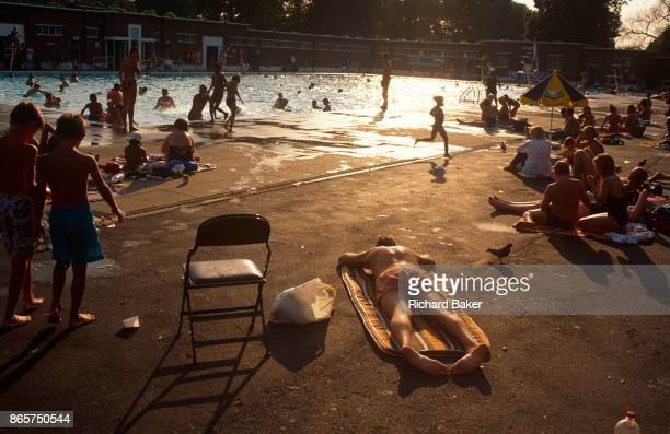 Sunbathers enjoy the poolside during the August heatwave on 20th August 1995 at Brockwell Lido Herne Hill London England