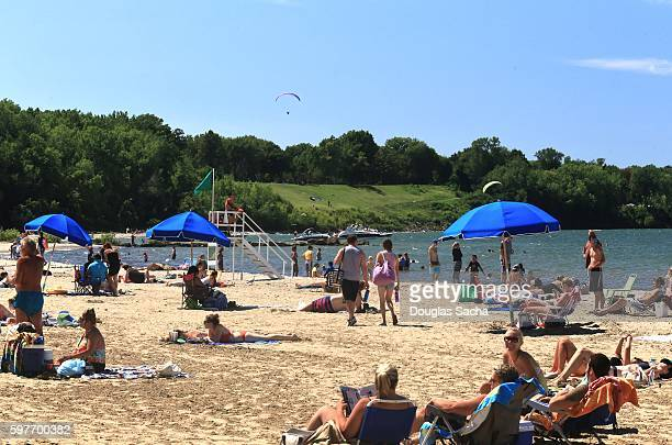 Sunbathers gather on the busy park beach, Edgewater State Park, Cleveland, Ohio, USA