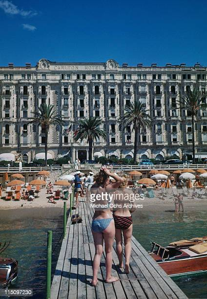 Sunbathers on a deck in front of the beach outside the Carlton Hotel in Cannes France in September 1948