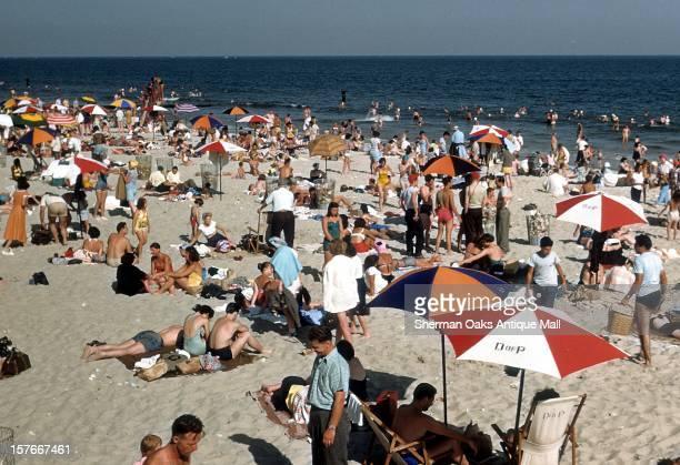 Sunbathers on Coney Island beach circa 1948 in Brooklyn New York City New York