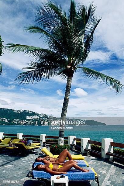 Sunbathers on Hotel Patio in Acapulco Bay