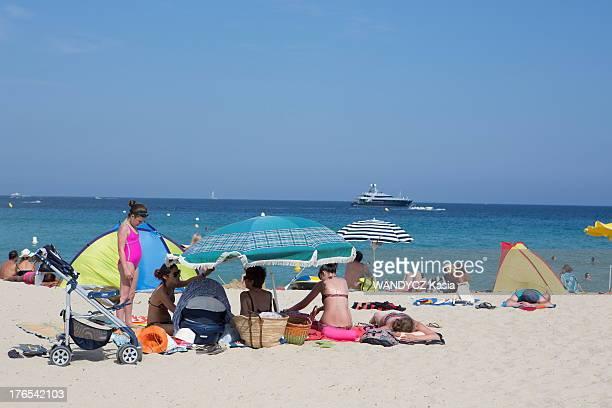 Sunbathers on Pamplonne beach on July 12 2013 in Saint Tropez France