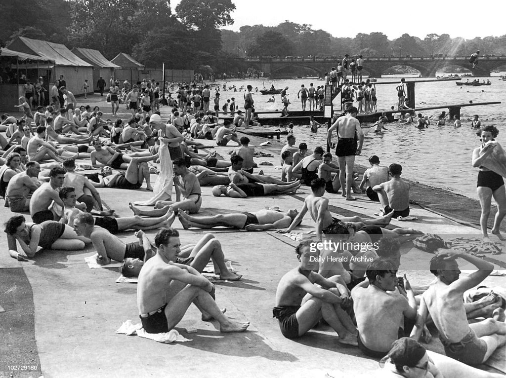 Sunbathing, 20 August 1939. Sunbathing, 20 August 1939. Daily Herald crowd of the Year sunbathing at the Serpentine Lido. Photograph by Sayer.