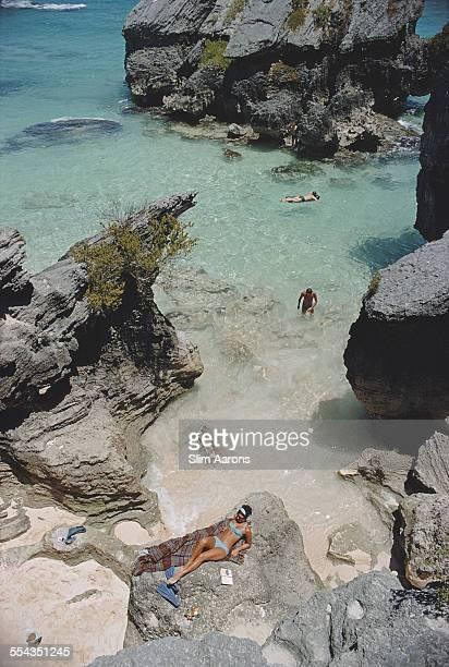 Sunbathing and swimming at a beach in Bermuda June 1967
