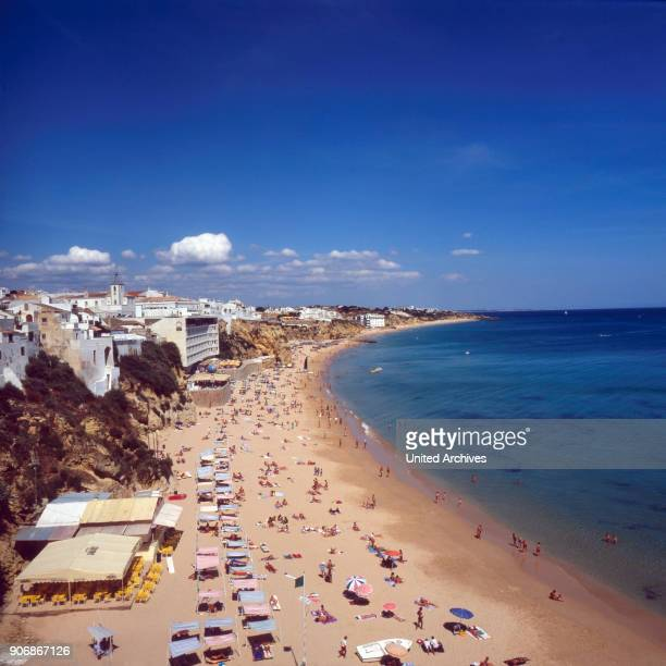 Sunbathing at Albufeira beach, Portugal 1980s.