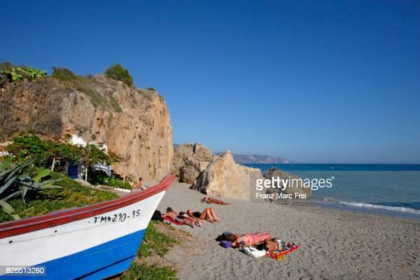 Sunbathing at Balcon de Europa beach, Nerja, Andalusia, Spain