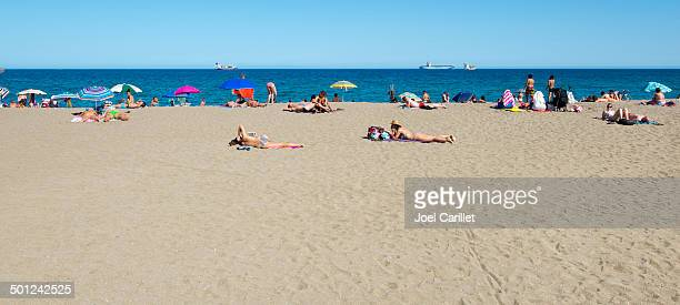 Sunbathing at beach in Malaga, Spain