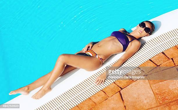 Sunbathing at the pool.